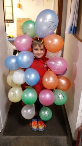 Scout Hunter Scott plays a water molecule with balloons representing impurities