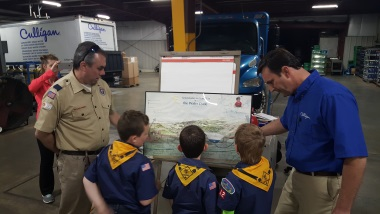 Production and Service Manager Chad Stretz shows the troop how water moves through nature - the Hydrologic Cycle